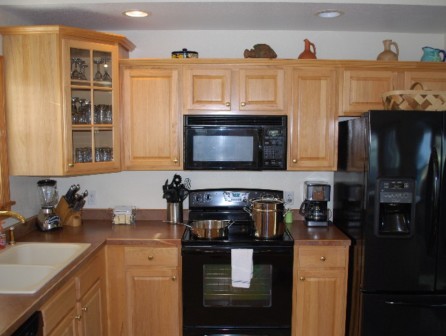 3rd Floor: Kitchen - Fully Stocked with Utensils, Pans, & Most Cooking Needs